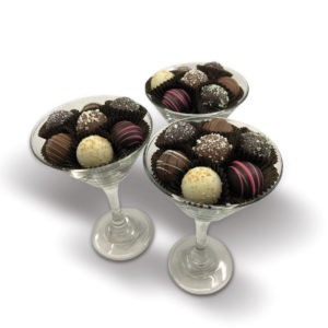 glass filled with assorted colorful truffles