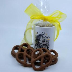ceramic mug filled with chocolate covered pretzels