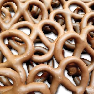 a pile of milk chocolate covered pretzels