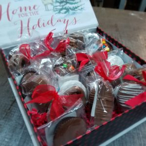Covid friendly holiday treat box filled with individually wrapped chocolates