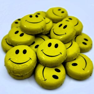 chocolate discs wrapped with smiley face foil