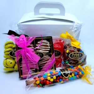 A candy care package with a candy assortment of chocolates and gummis