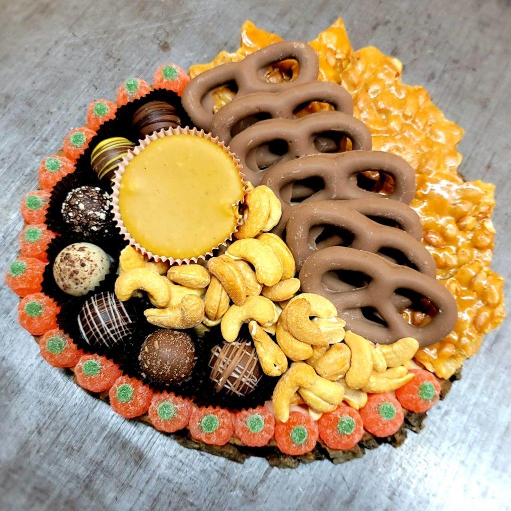 Charcuterie Board with Truffles, pumpkin pie fudge pretzels peanut brittle and jelly pumpkins