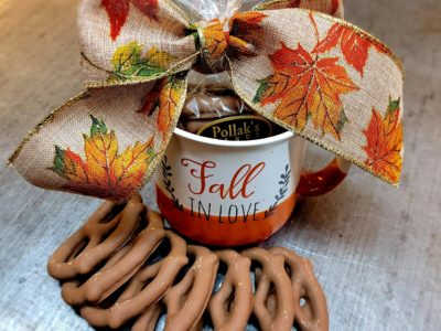 Mug saying Fall in Love filled with milk chocolate covered pretzels